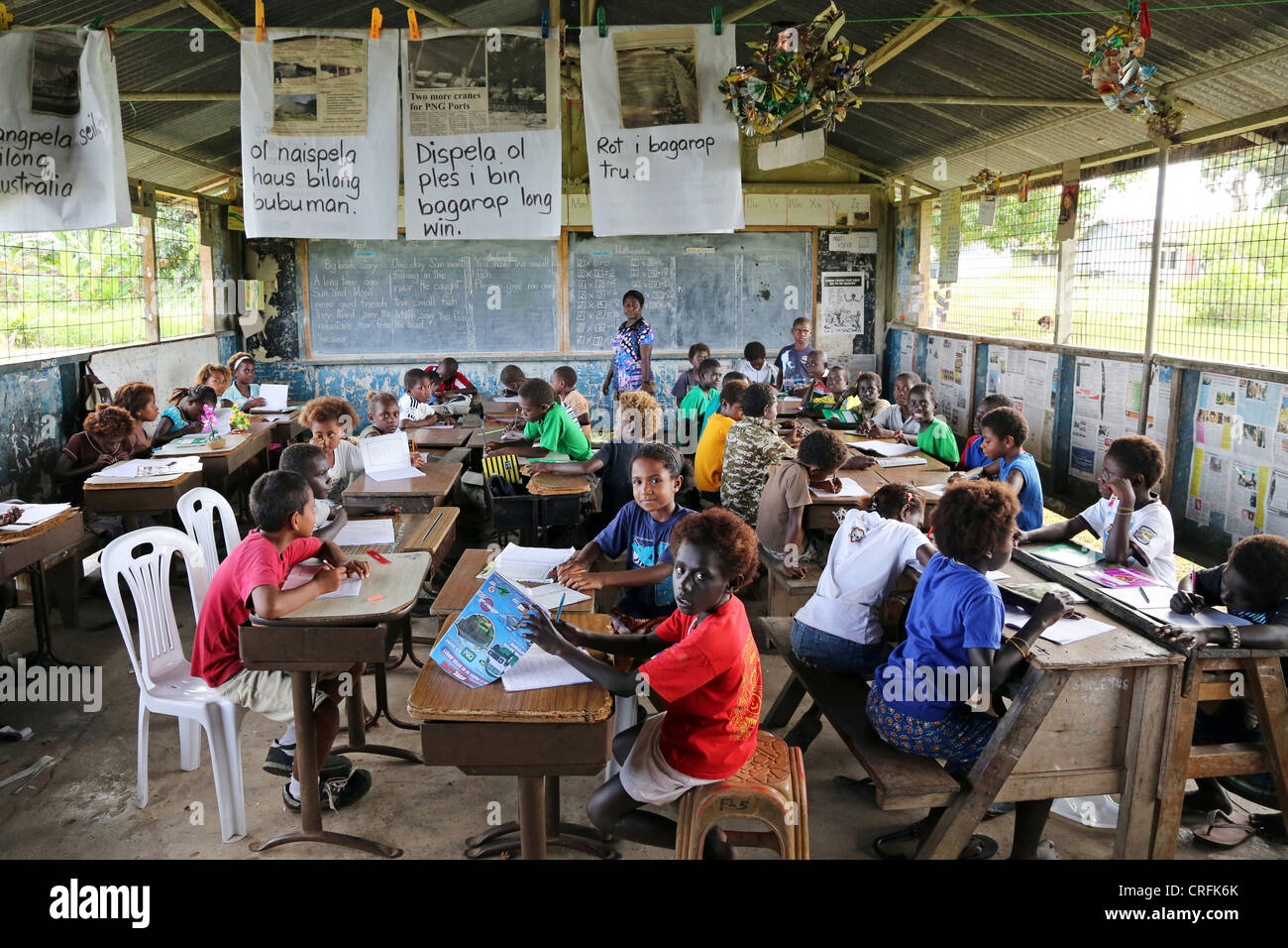 Pupils in a classroom of a primary school in Buka, Bougainville Island, Papua Neuguinea - Stock Image