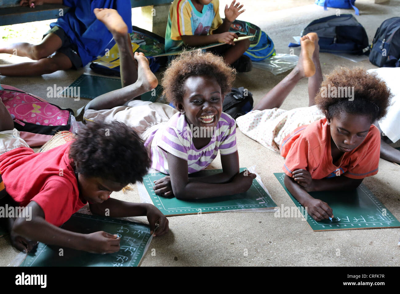 smiling girls in a classroom of a primary school in Buka, Bougainville Island, Papua Neuguinea - Stock Image