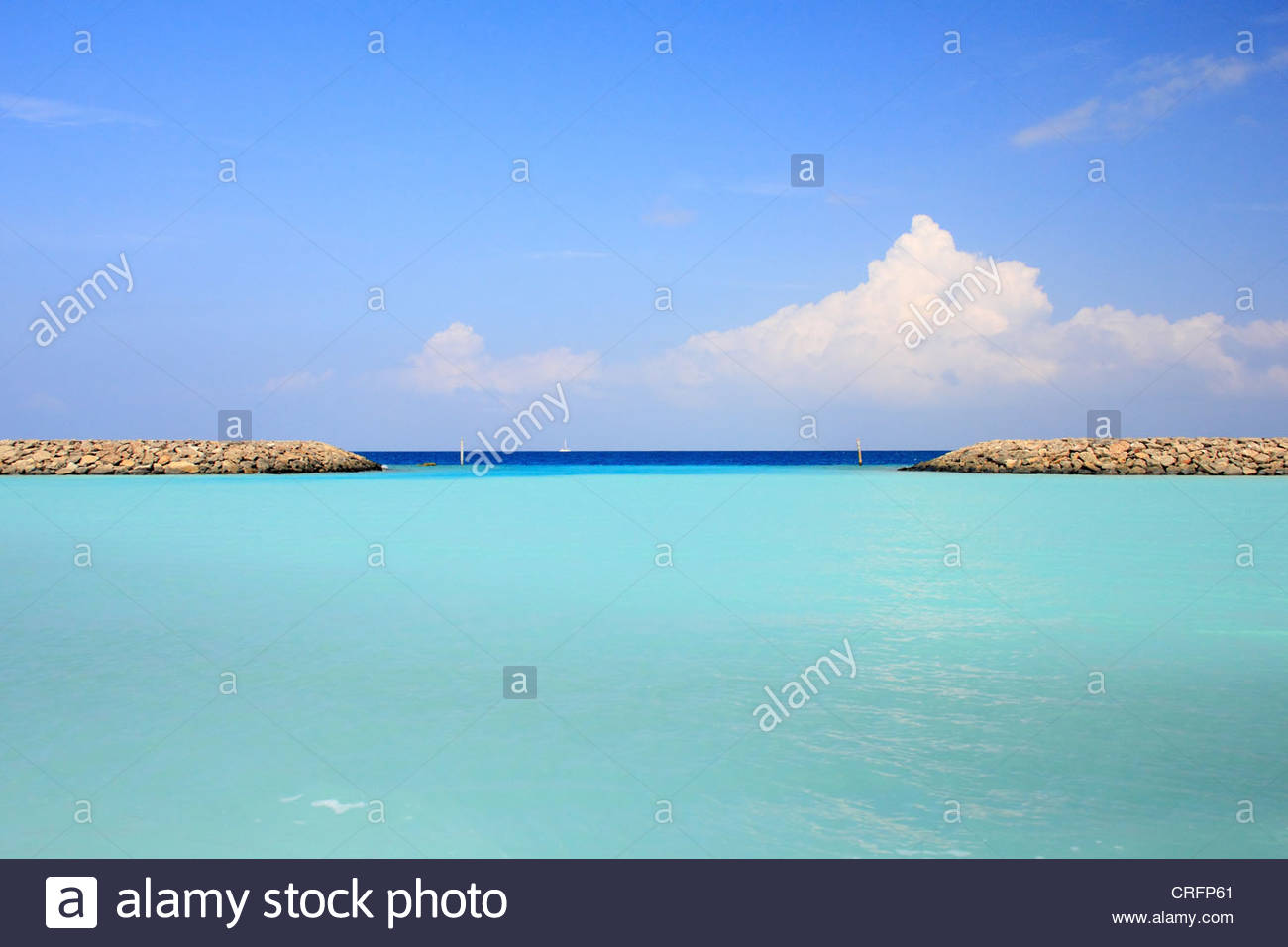 Stone walls on tropical waters - Stock Image