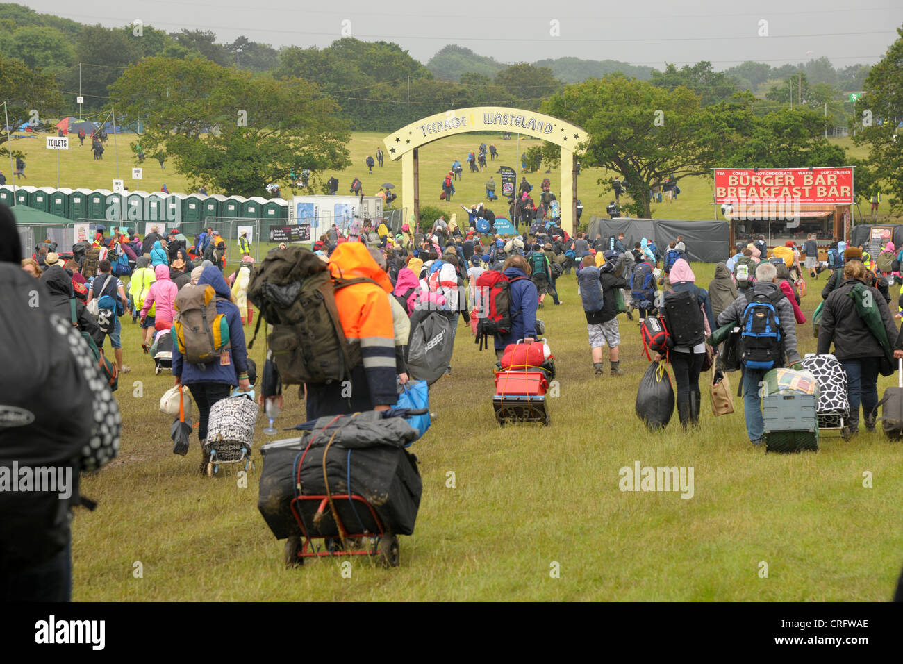 Heavy rain and traffic congestion brings chaos to the Isle of Wight festival but revelers flood in to the venue Stock Photo