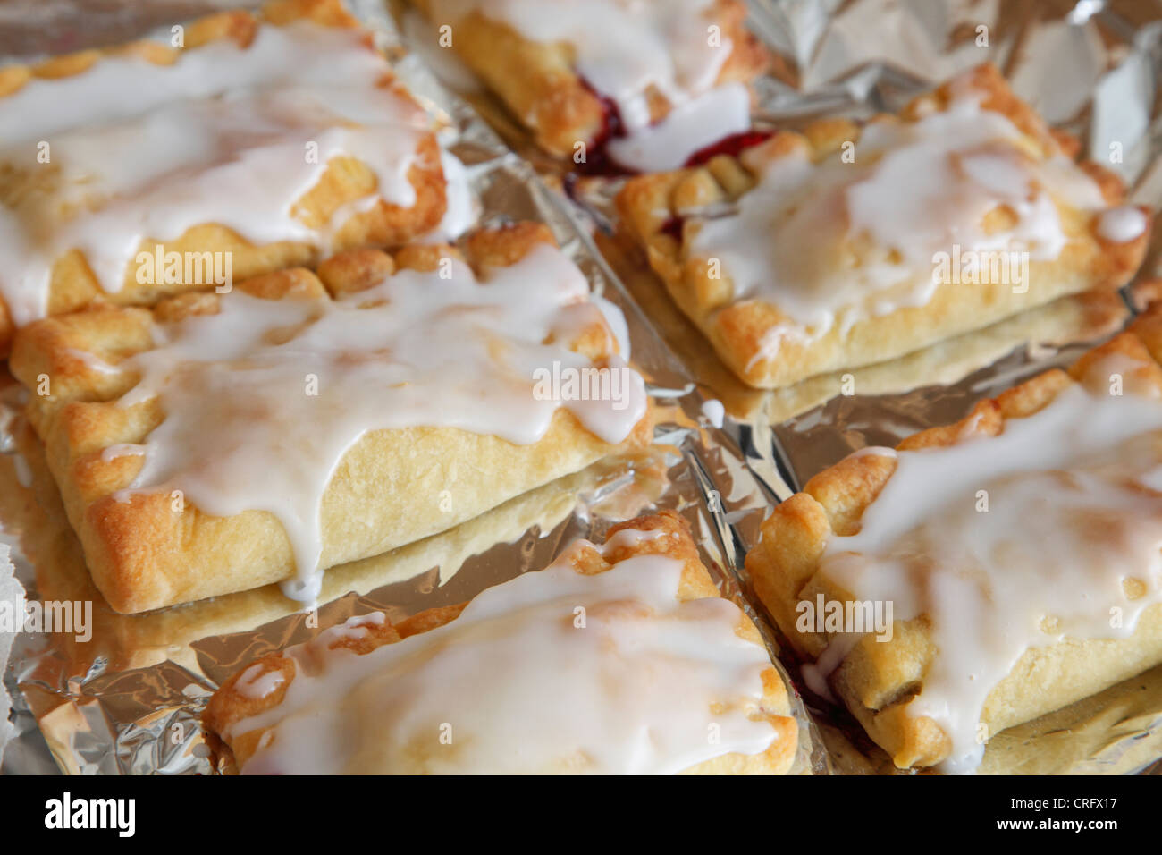 sugar coated flaky pastry filled with marmalade - Stock Image