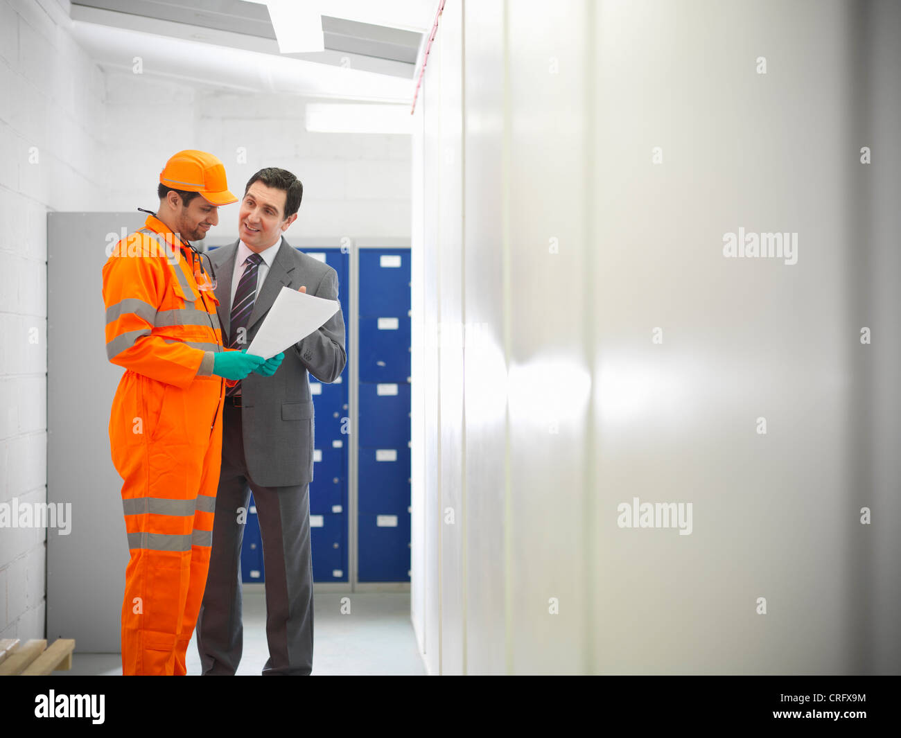 Apprentice engineer with businessman Stock Photo