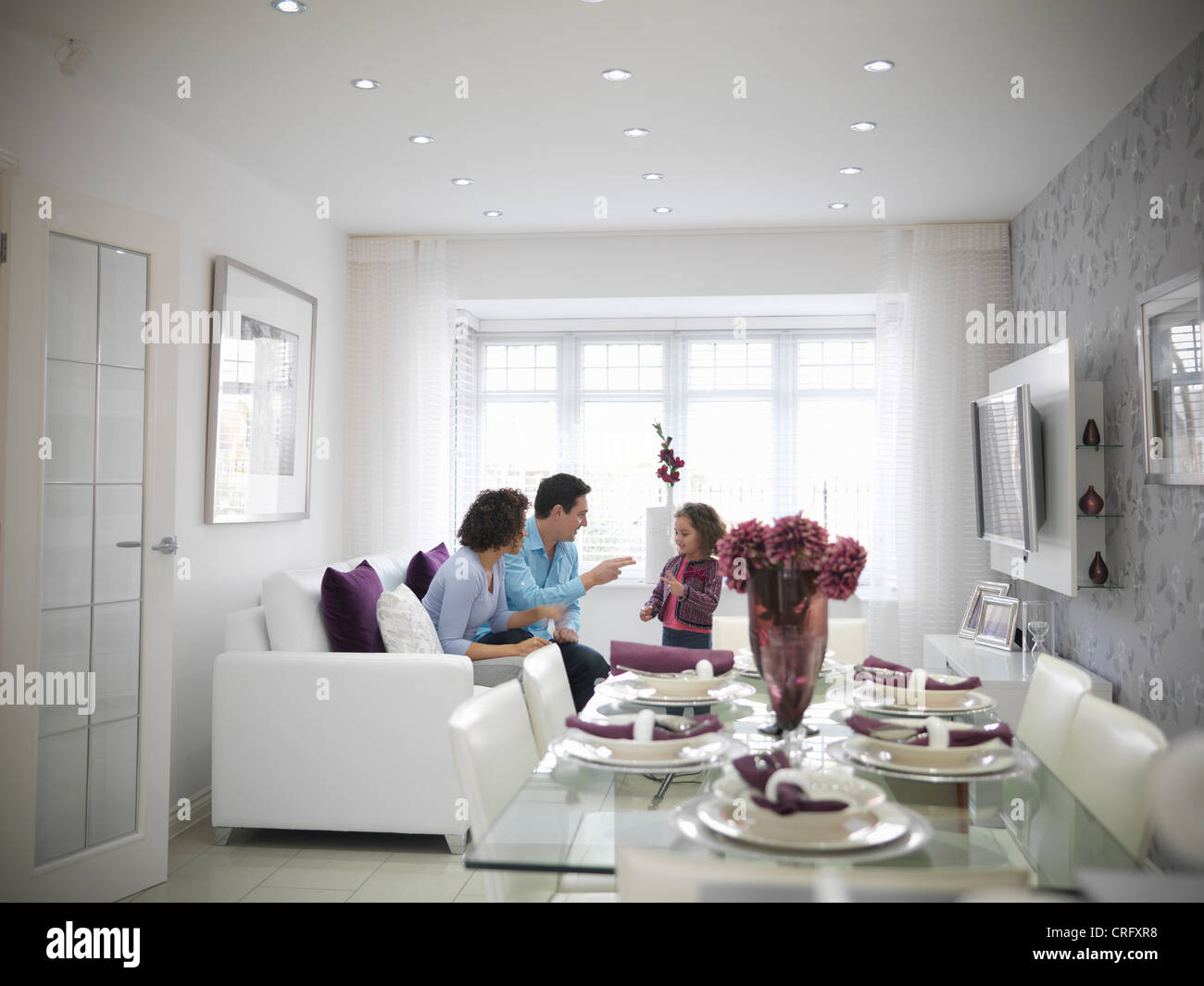 Family relaxing together in living room Stock Photo: 48908140 - Alamy