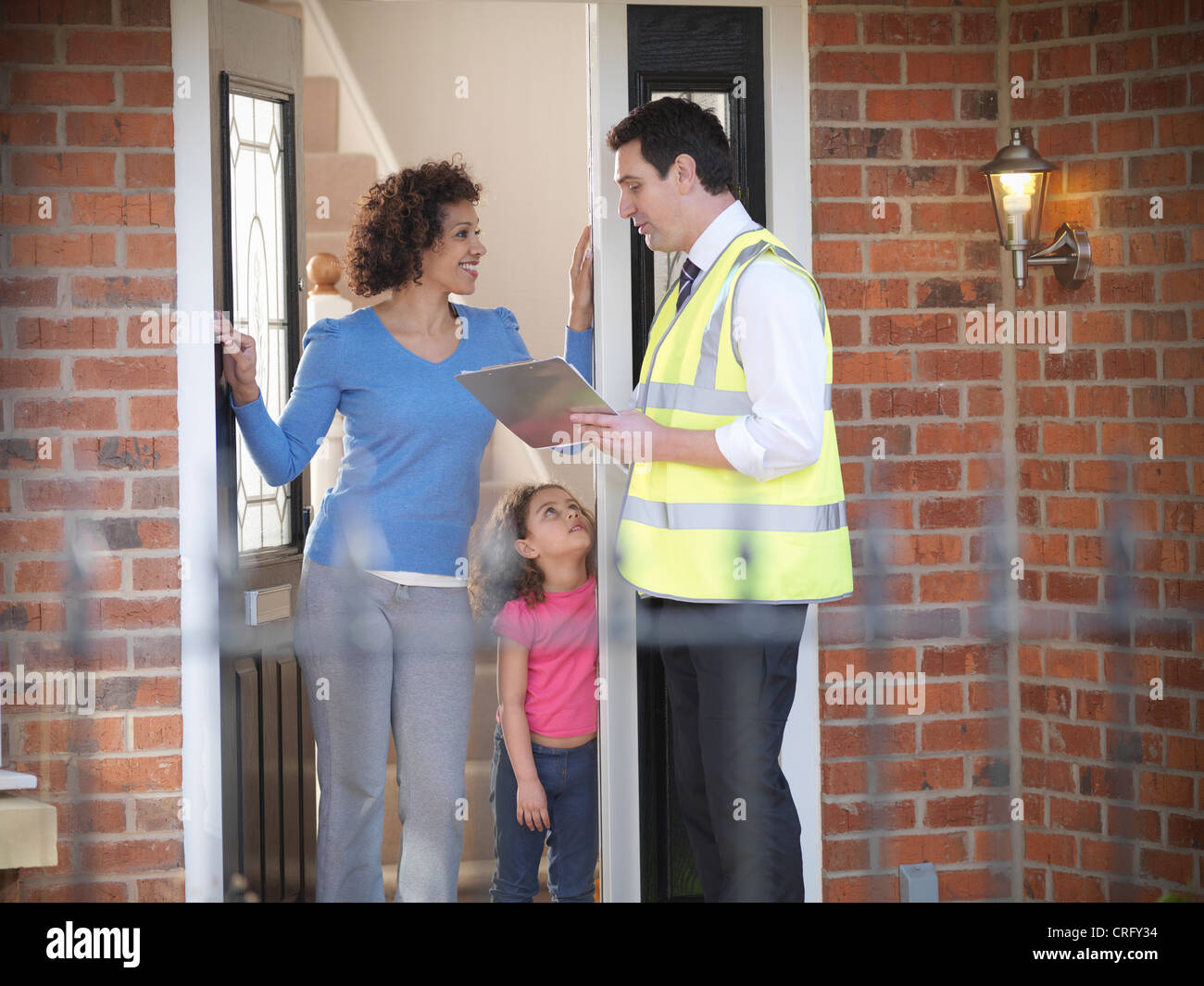 Energy worker talking to family Stock Photo