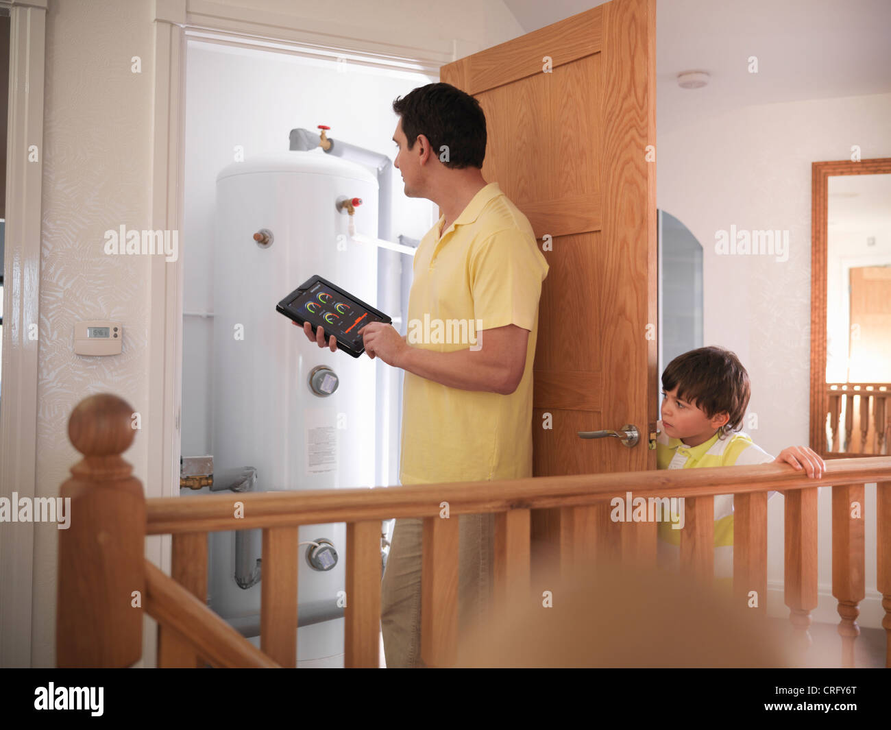 Man checking energy levels in home - Stock Image