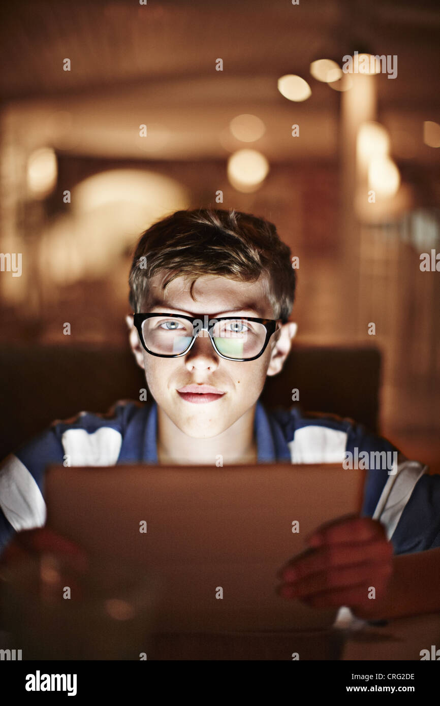 Man illuminated by tablet computer - Stock Image