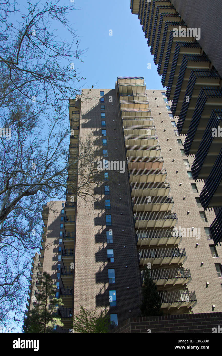 Upward view of multi story apartment building and condominiums - Stock Image