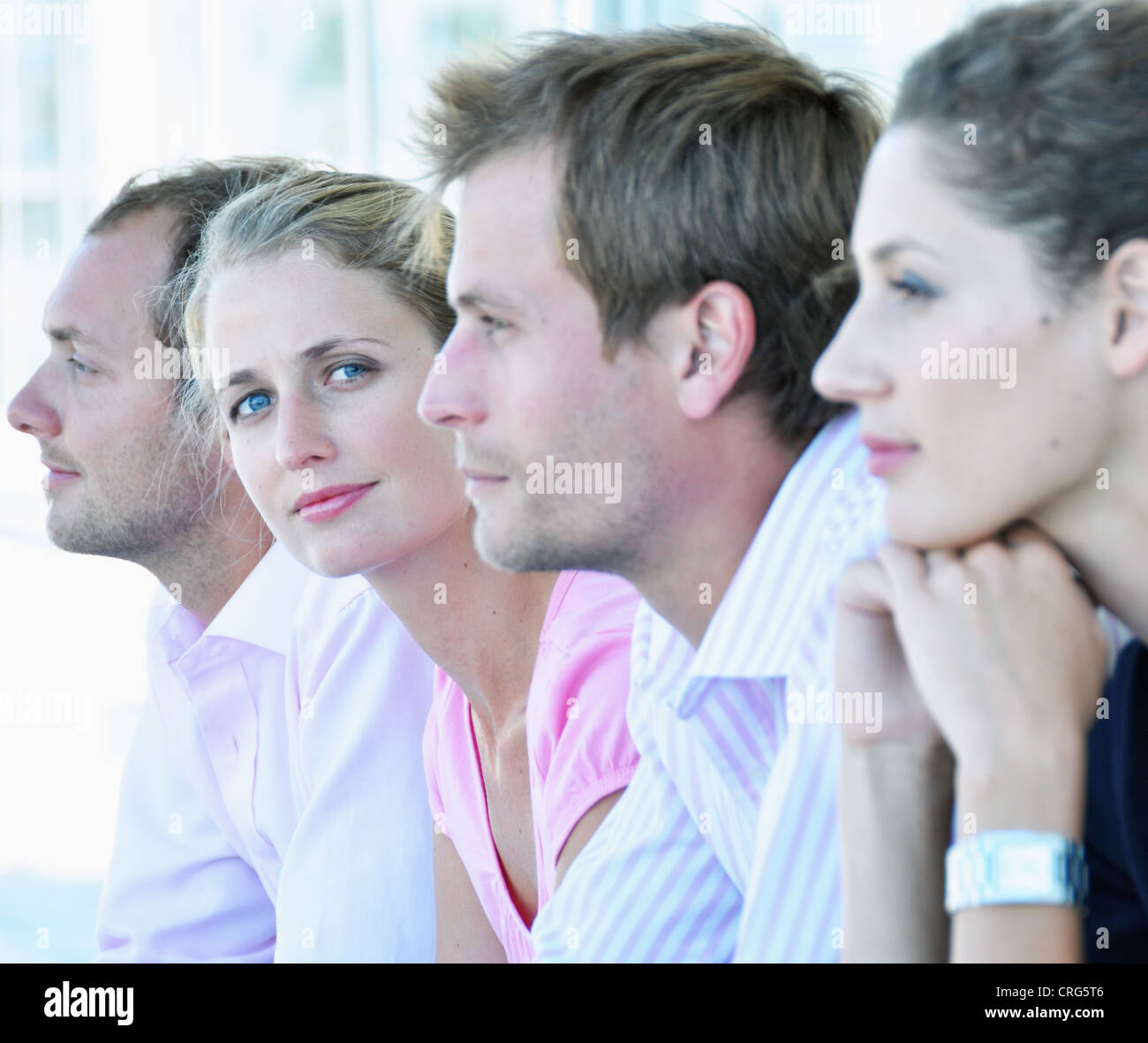 Businesswoman sitting with colleagues - Stock Image