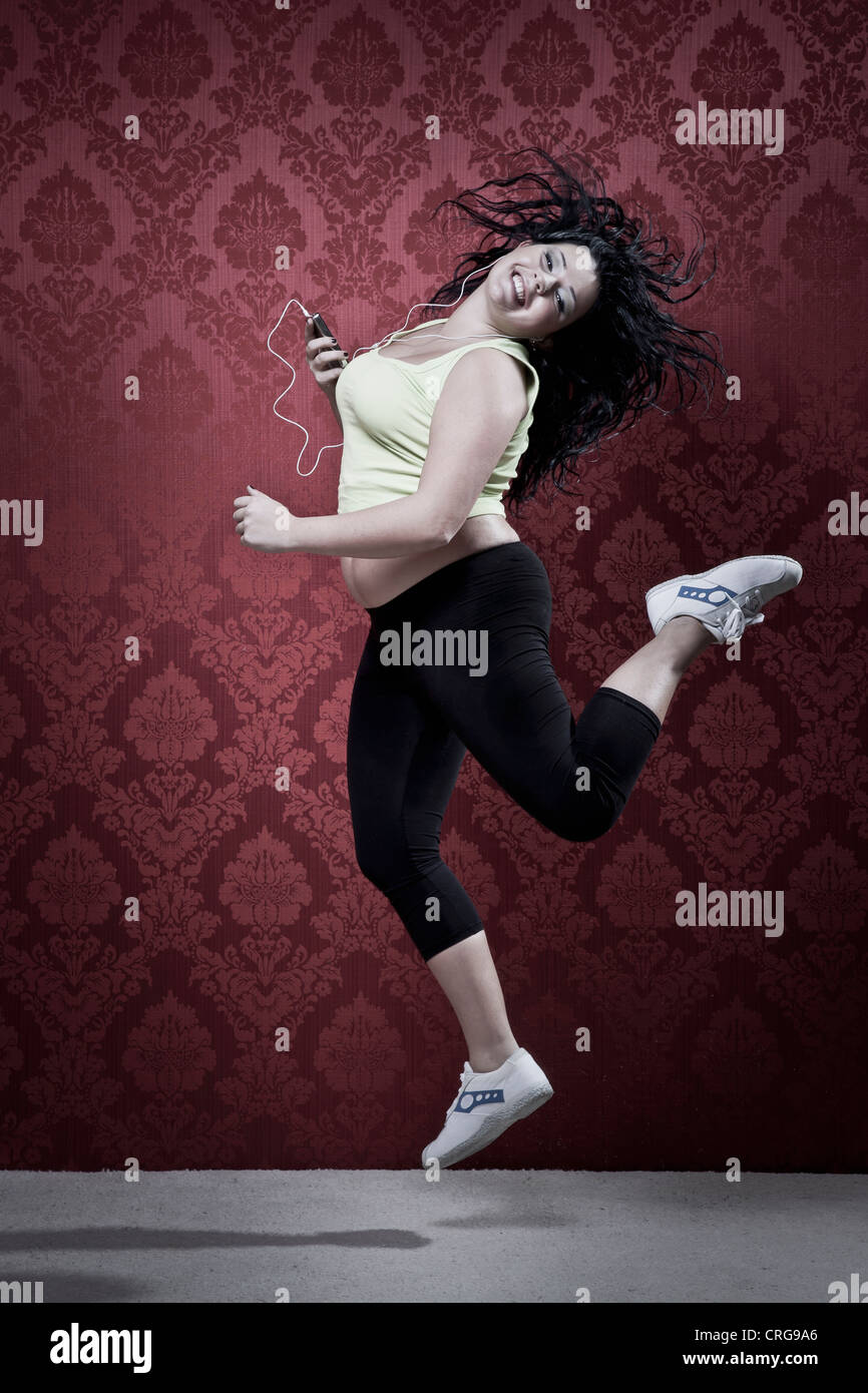 Woman listening to headphones in workout - Stock Image