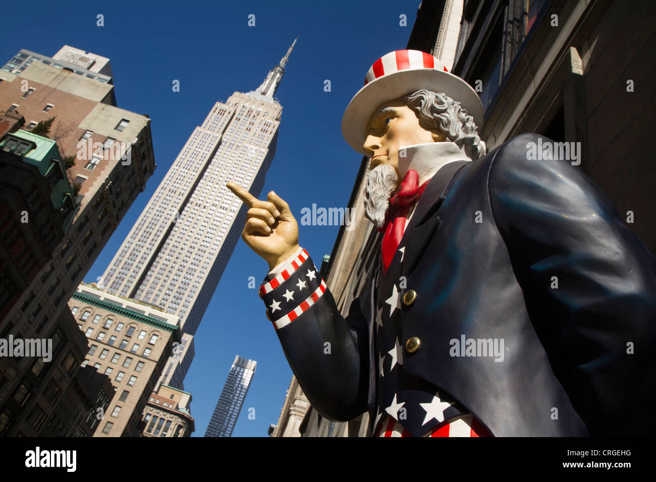 Uncle Sam points in the direction of Empire State Building - Stock Image