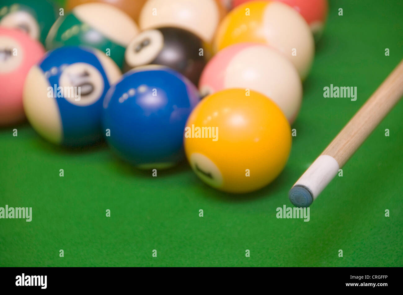 billiard balls and billiard cue - Stock Image