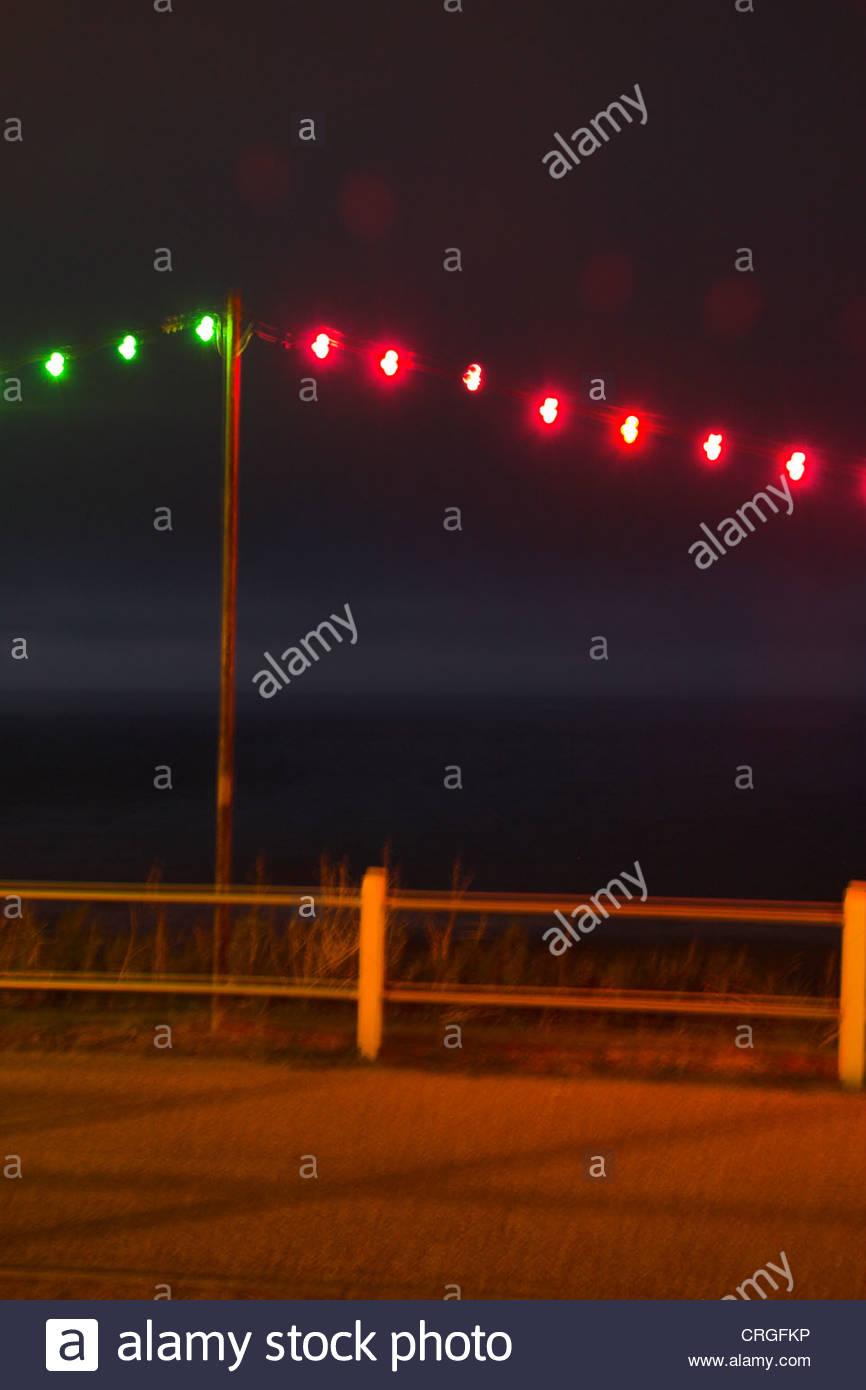 Hanging colourful lights on the promenade at night, Cromer, Norfolk, UK. - Stock Image