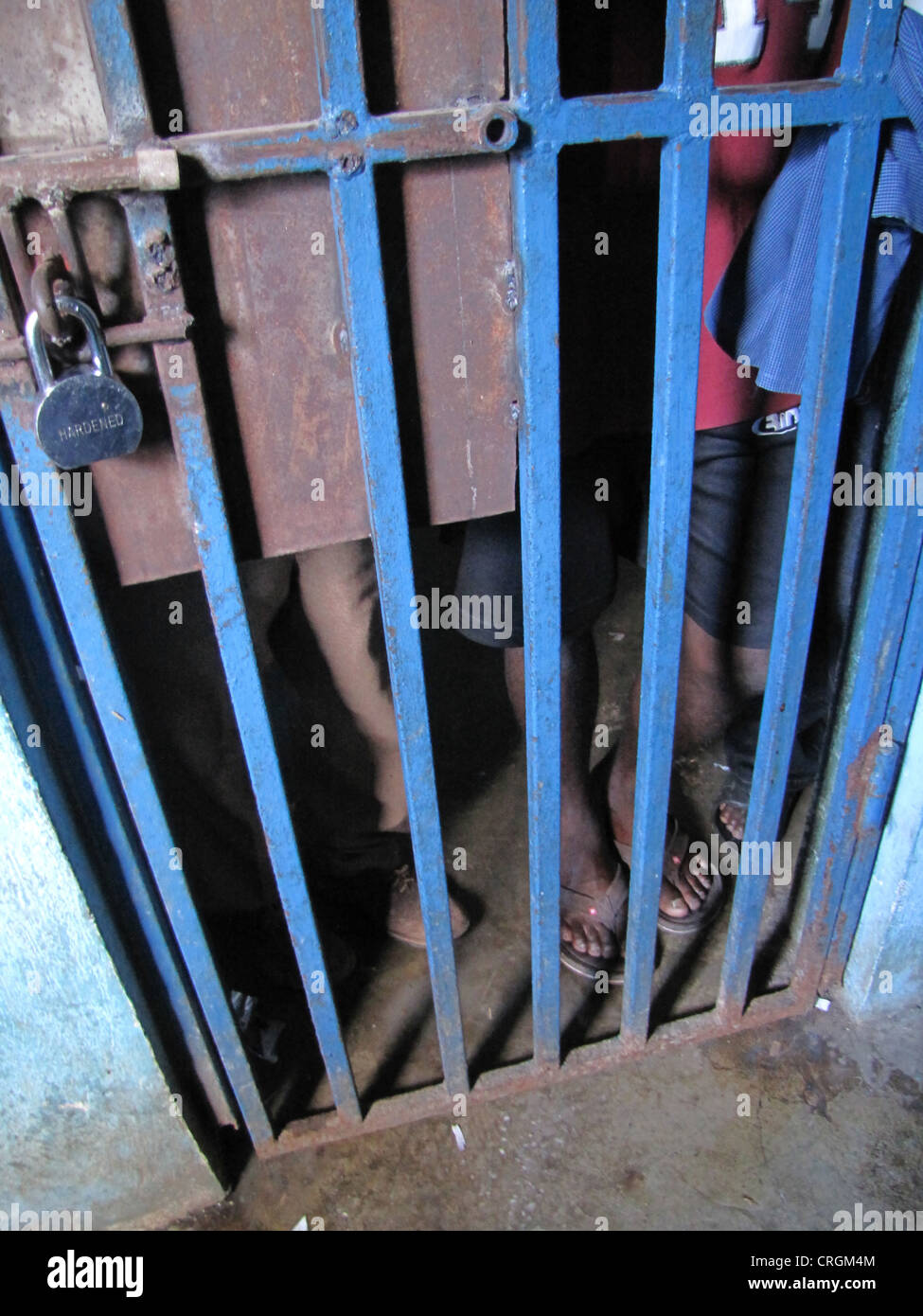 Detainees behind bars in run-down predetention cell in police station, Haiti, Grande Anse, Jeremie - Stock Image