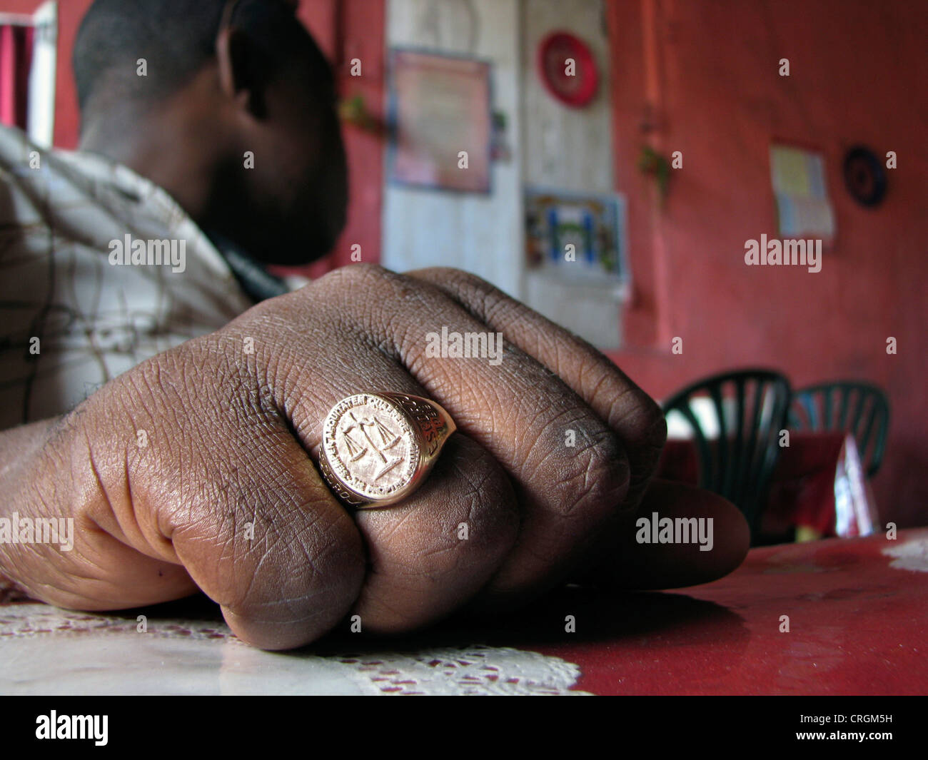 signet ring of the official legal order at a Haitian lawyer's hand, Haiti, Grande Anse, Les Irois - Stock Image