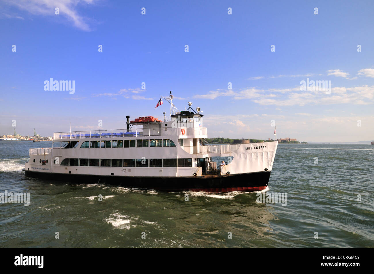 The excursion boat Miss Liberty on its way to the Statue of Liberty and Ellis Island from Battery Park, New York - Stock Image