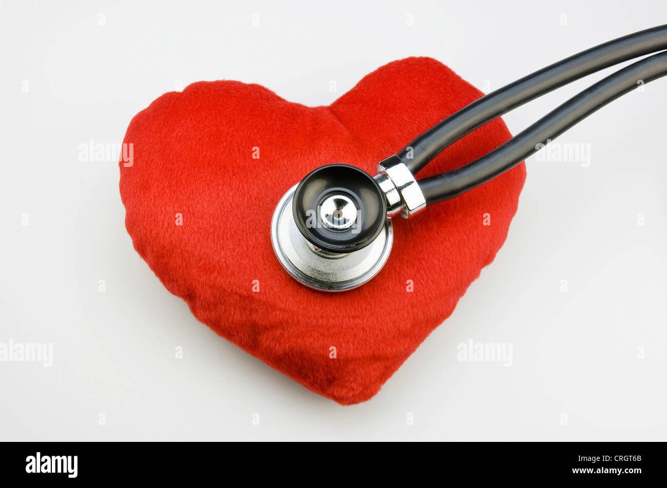 stuffed heart being examined with stethoscope - Stock Image
