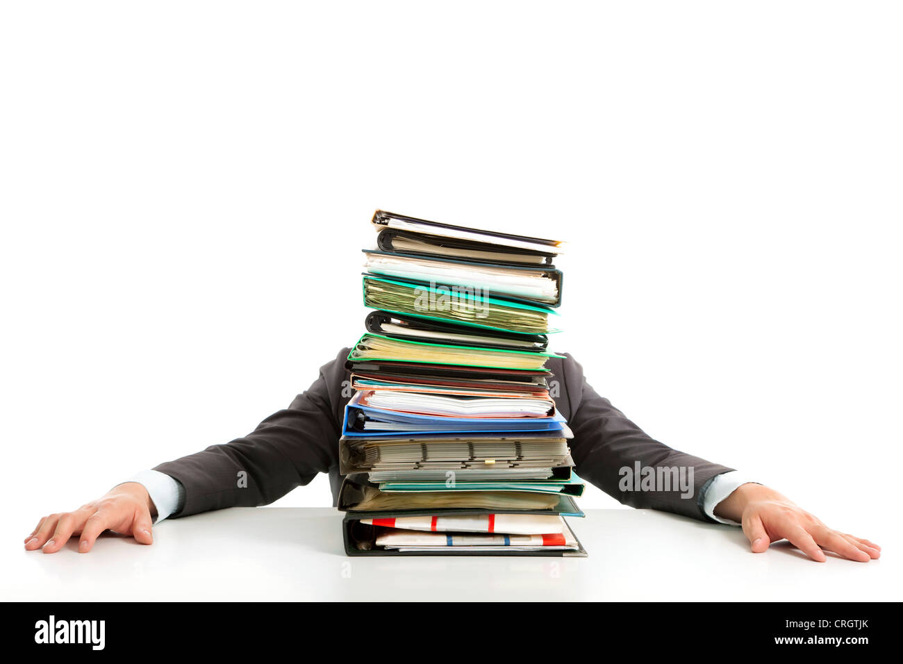 tired Businessman hiding behind paperwork - Stock Image