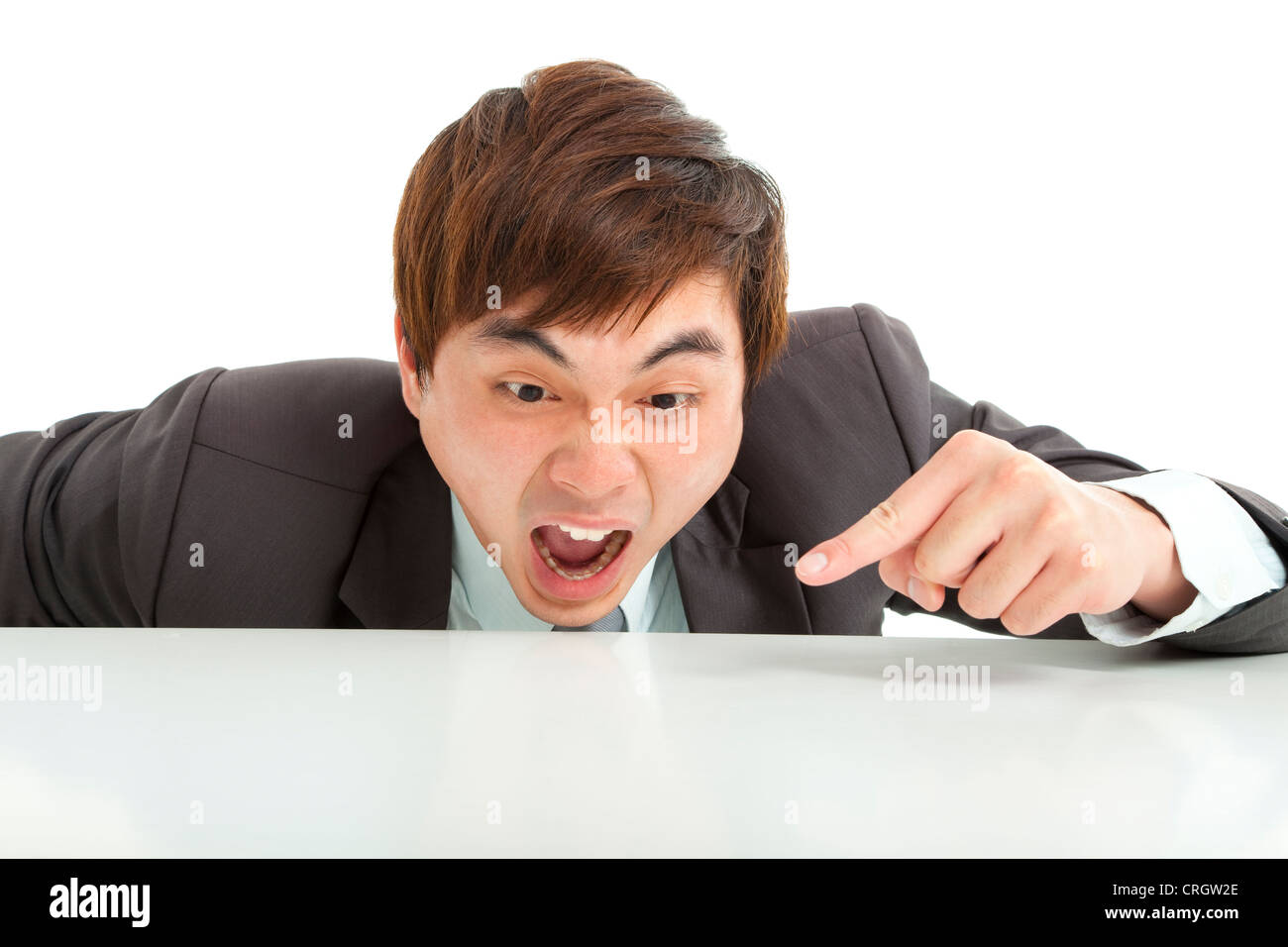 angry businessman pointing something on the table - Stock Image