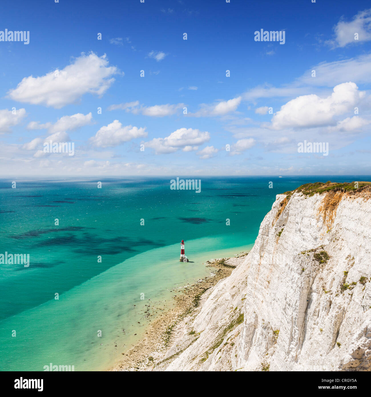 The famous red and white striped lighthouse at the foot of the chalk cliffs at Beachy Head, Sussex, England, - Stock Image