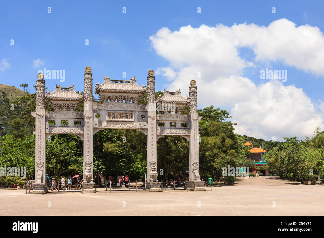 Tourists at the main gate of Po Lin Monastery on Lantau Island, Hong Kong. - Stock Image