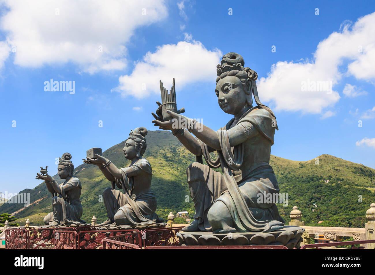 Statues of Devas making offerings at Tian Tan Buddha image on Lantau Island, Hong Kong - Stock Image