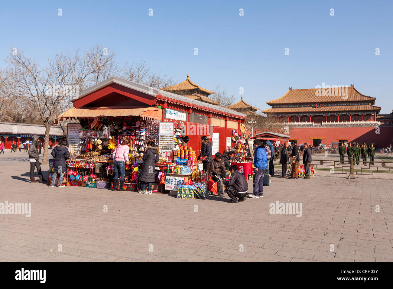 Tourists surround a souvenir stall at the Forbidden City, Beijing, China - Stock Image