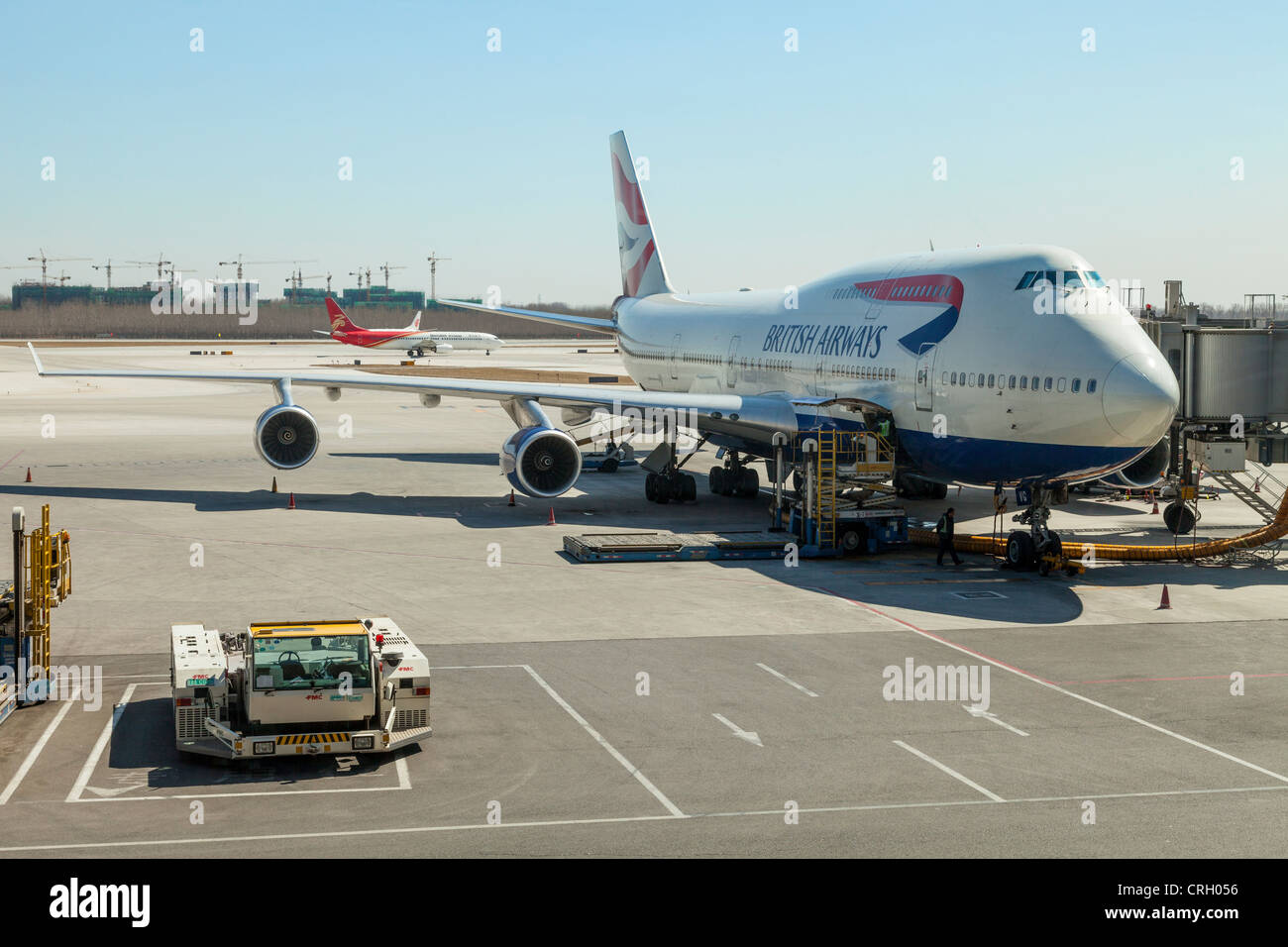 British Airways 747-400 on the tarmac at Beijing International Airport. In the background is a Boeing 737 of Shenzhen - Stock Image