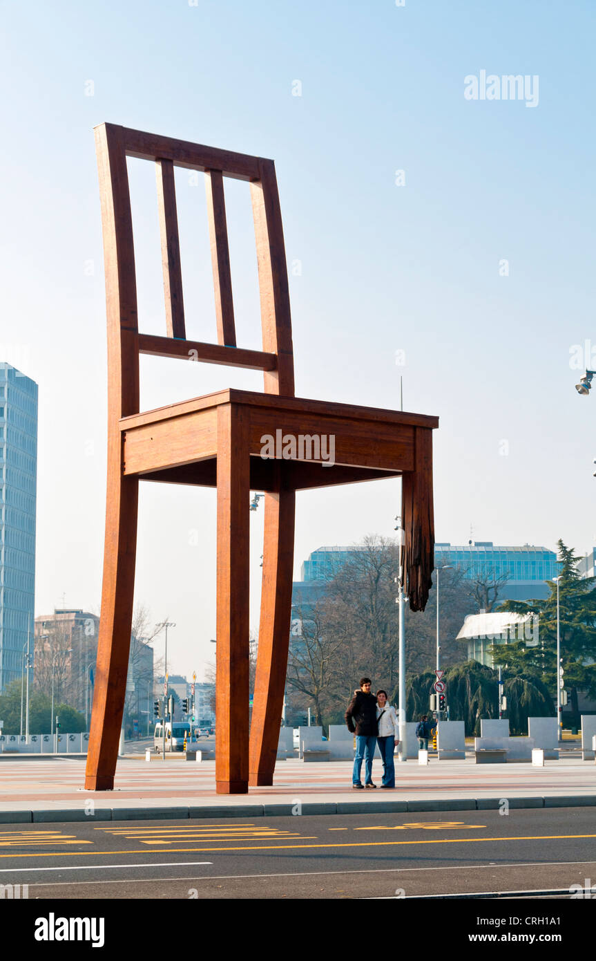 Broken Chair modern art sculpture in Place des Nations, Geneva, Switzerland - Stock Image