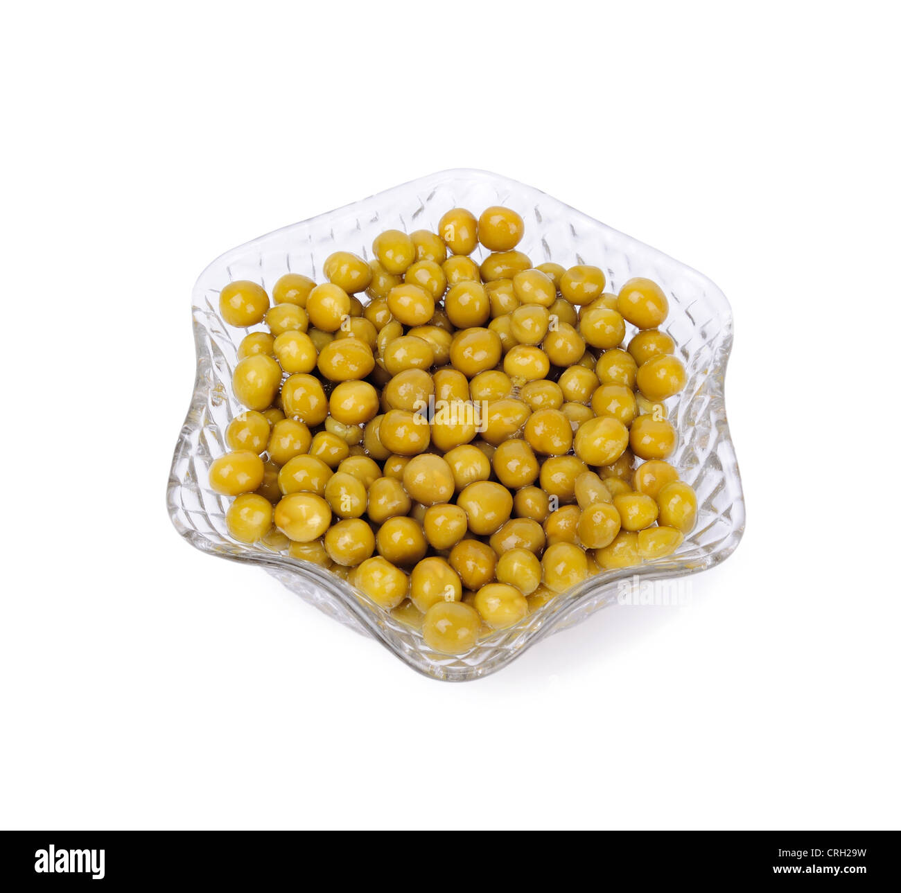 Preserved peas in crystal bowl isolated on a white background - Stock Image