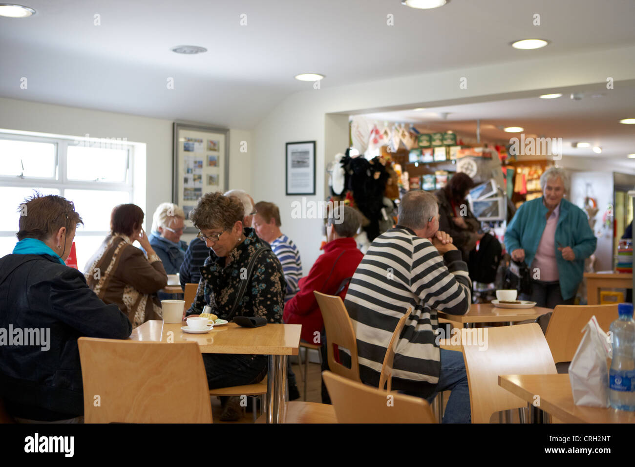 people inside the national trust weighbridge tearoom at carrick-a-rede county antrim northern ireland uk - Stock Image