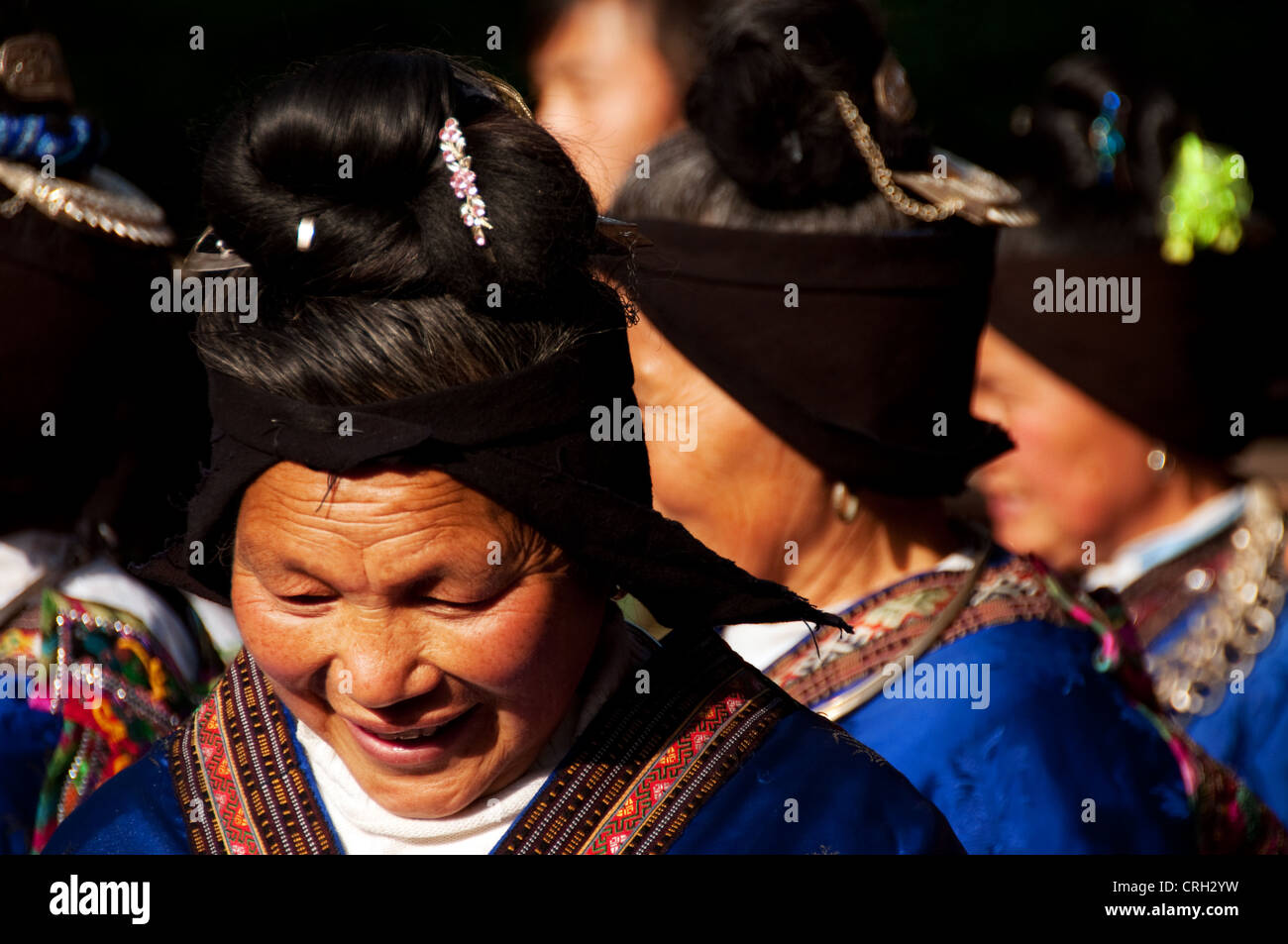 Miao elderly woman while performing traditional songs, Xijiang Miao village, China - Stock Image