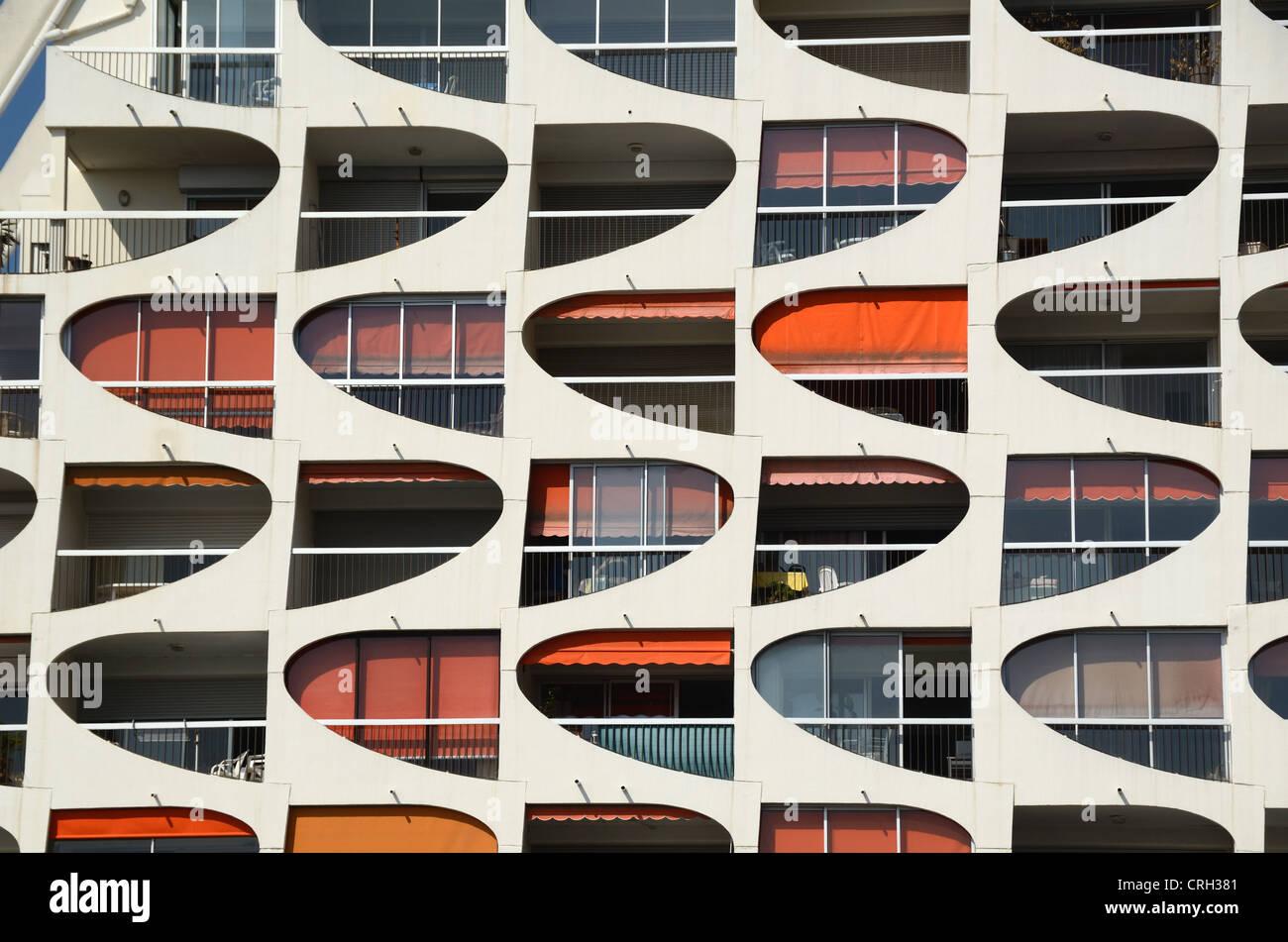 Window Patterns of Modernist Apartment Building or Block of Holiday Flats at La Grande-Motte Hérault France - Stock Image