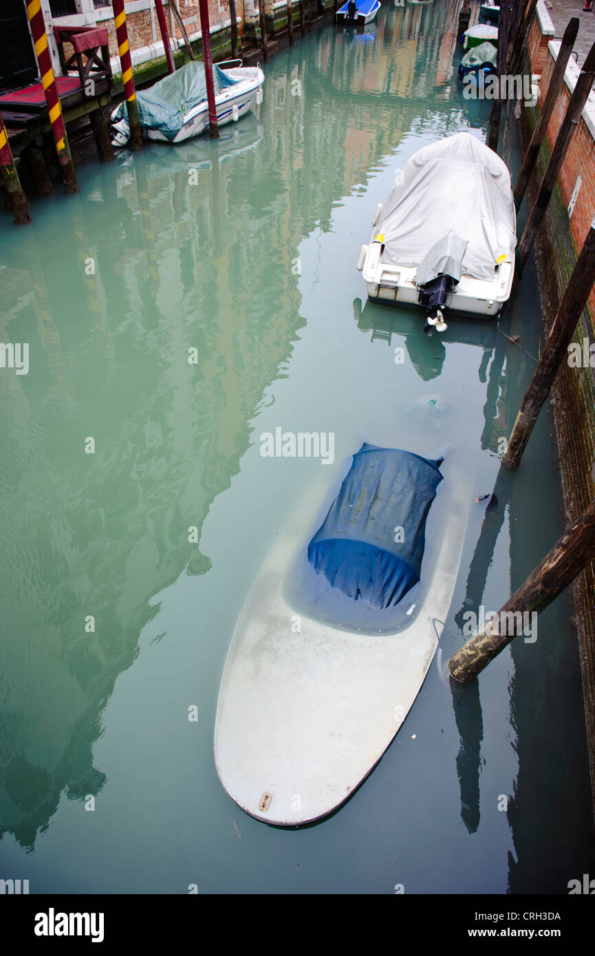 sunk boat in a canal of Venice, Veneto, Italy, - Stock Image