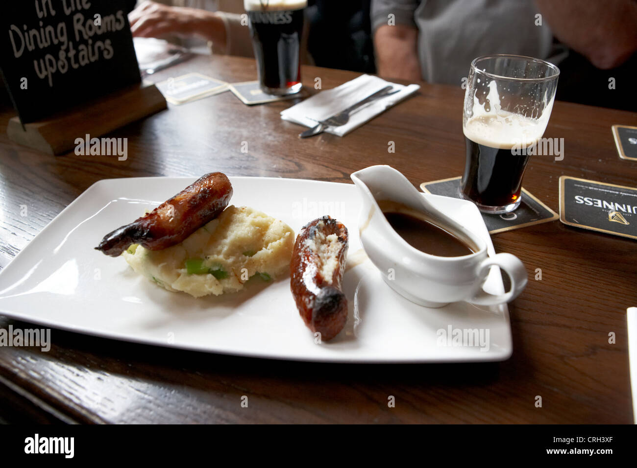 champ and sausages with guinness for lunch in a pub in ireland - Stock Image