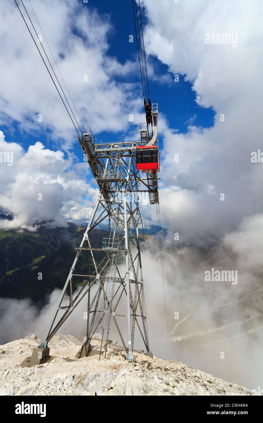 summer view of Primiero valley with cableway pylon on foreground, San Martino di Castrozza, Trentino, Italy Stock Photo