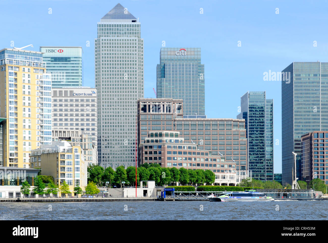 View across River Thames at high tide towards London Docklands Canary Wharf skyline - Stock Image