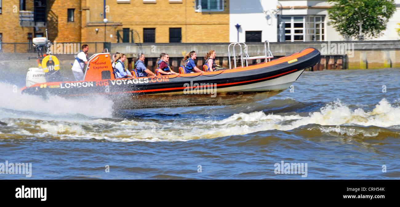 London RIB Voyages River Thames sightseeing boat moving at High speed near Canary Wharf - Stock Image