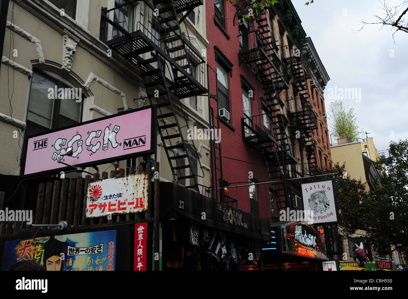 Ornate tenements with \'Sock Man\' clothes shop, \'Addiction NYC ...