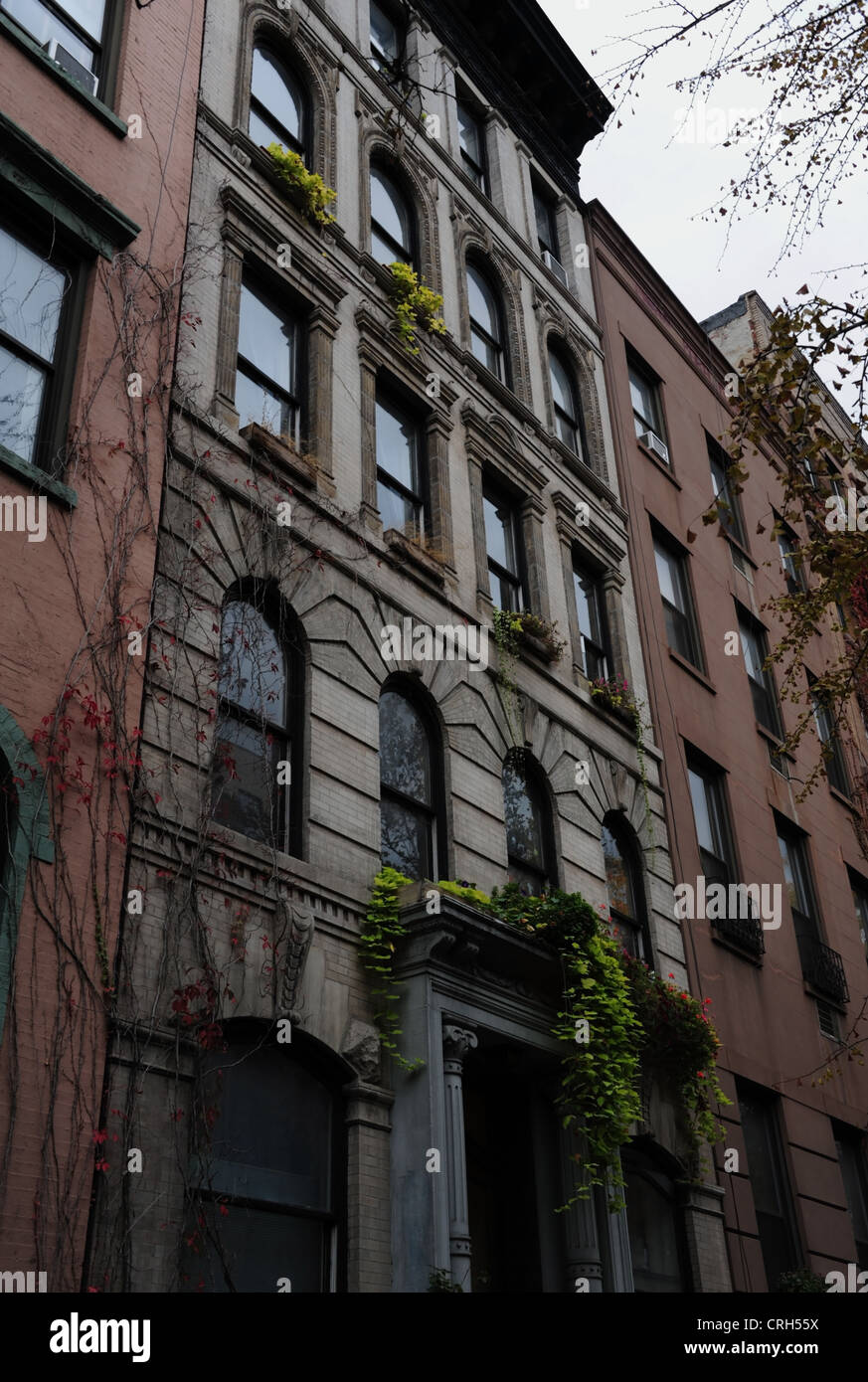 Grey sky autumn portrait red ivy green window boxes ornate grey masonry tenement, 51 St. Mark's Place, East - Stock Image