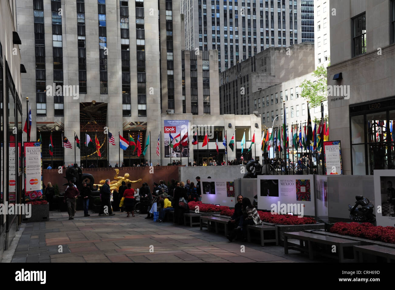 View of people and 'Revealing Mexico Week' artwork displays, towards GE Building, Channel Gardens, Rockefeller Centre, Stock Photo