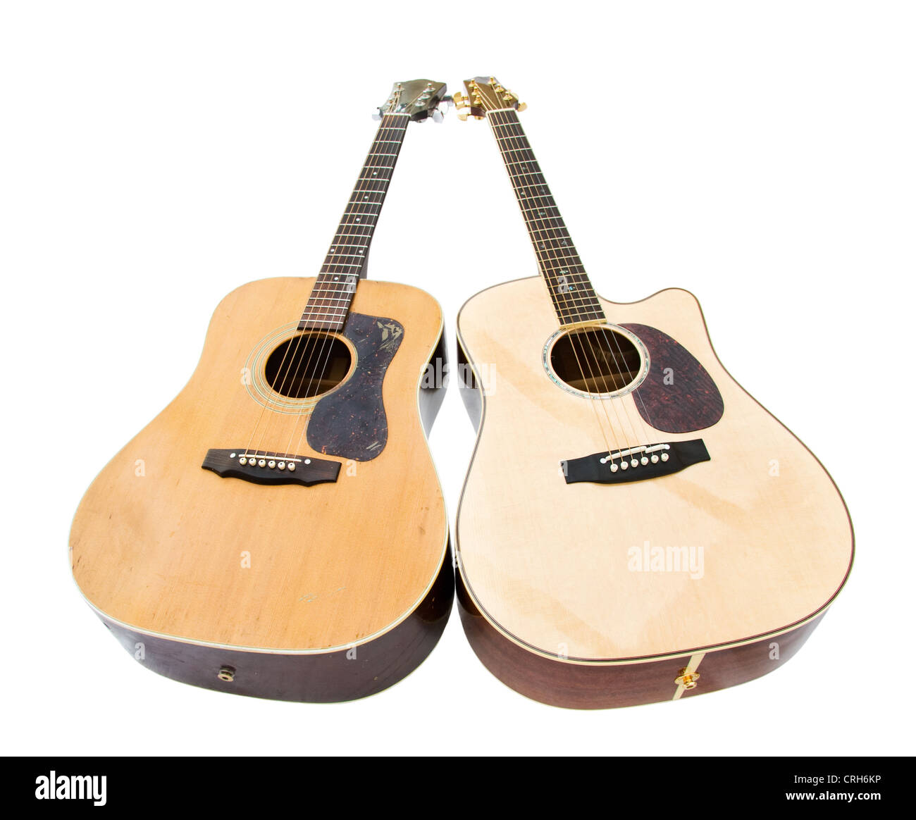 Pair of two acoustic guitars - old and new. Isolated over white background. - Stock Image