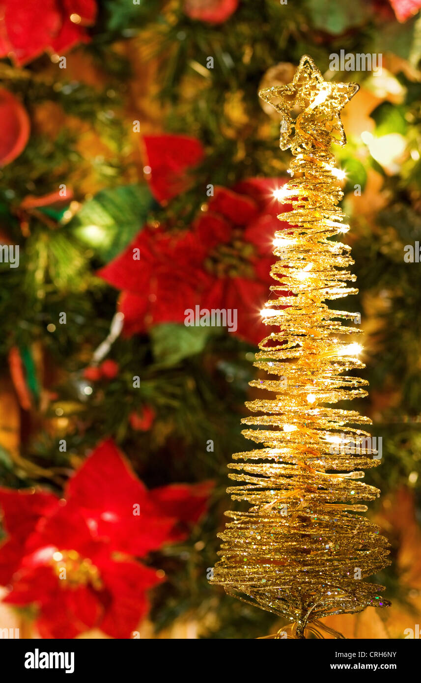 Christmas Eve Magic - greeting card with golden lights and decorated tree - Stock Image
