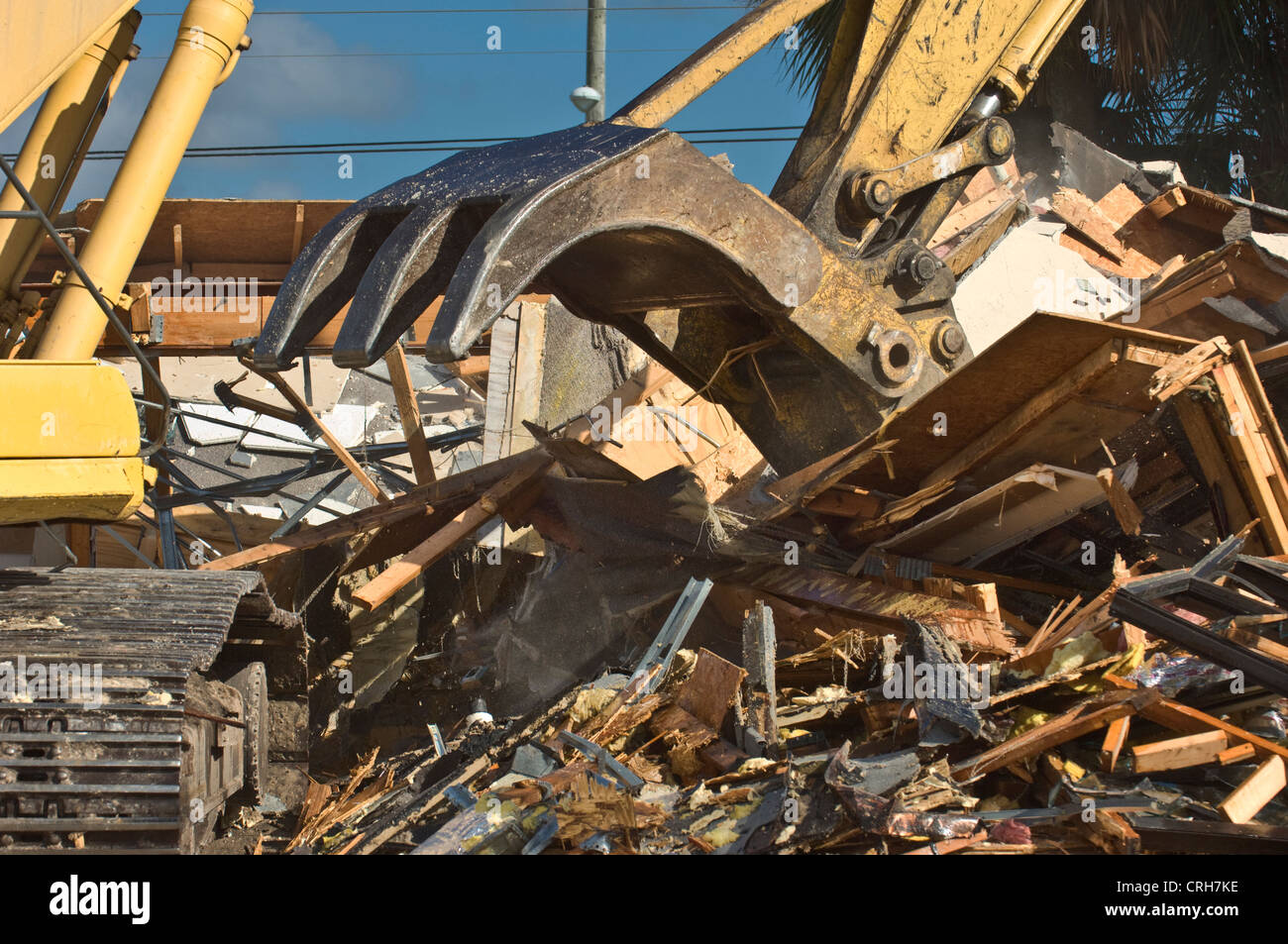 building demolition with giant claw - Stock Image