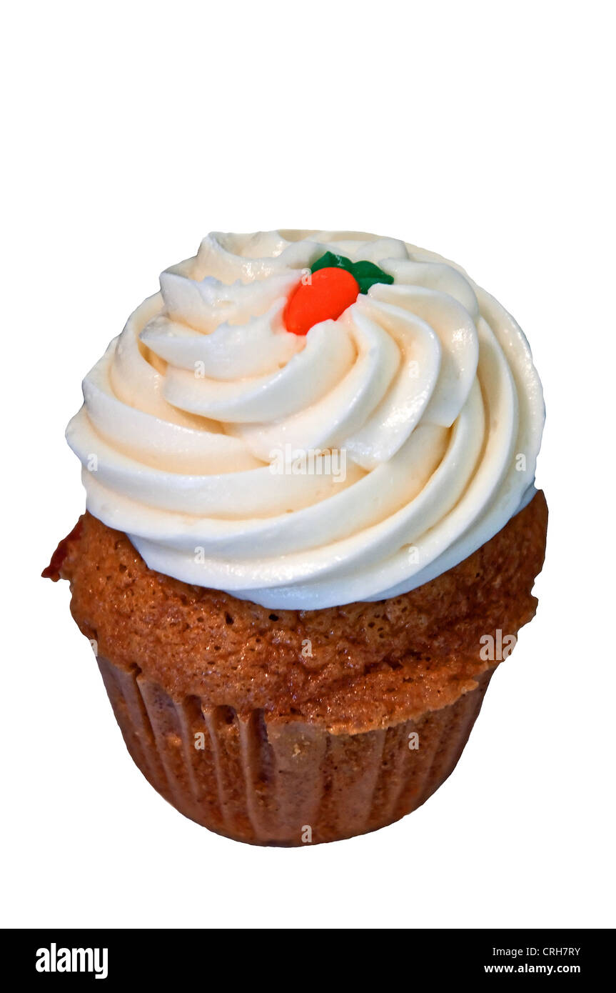 This closeup is a carrot cupcake with lots of swirled cream cheese frosting with a carrot in icing on top, on an - Stock Image