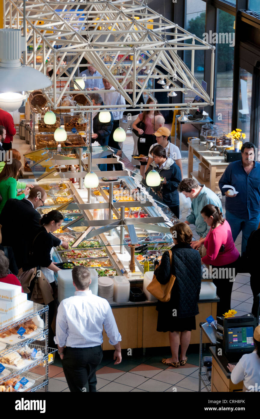 People getting breakfast from the buffet at famous Au Bon Pain cafe in Boston, Massachusetts, USA - Stock Image