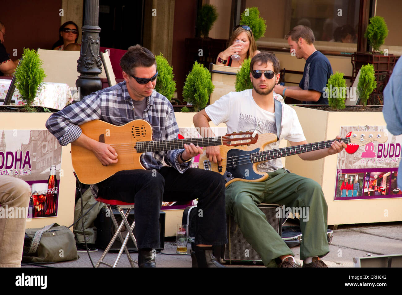 Two men playing guitar in the streets of Gdansk Poland - Stock Image