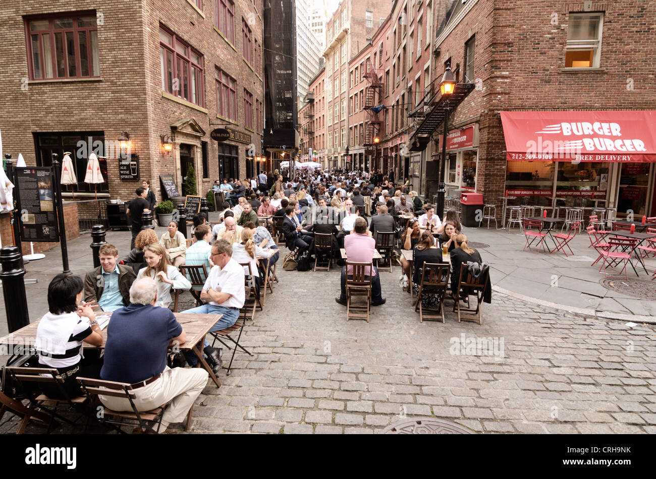 Stone Street in Lower Manhattan is a popular outdoor hot spot. - Stock Image
