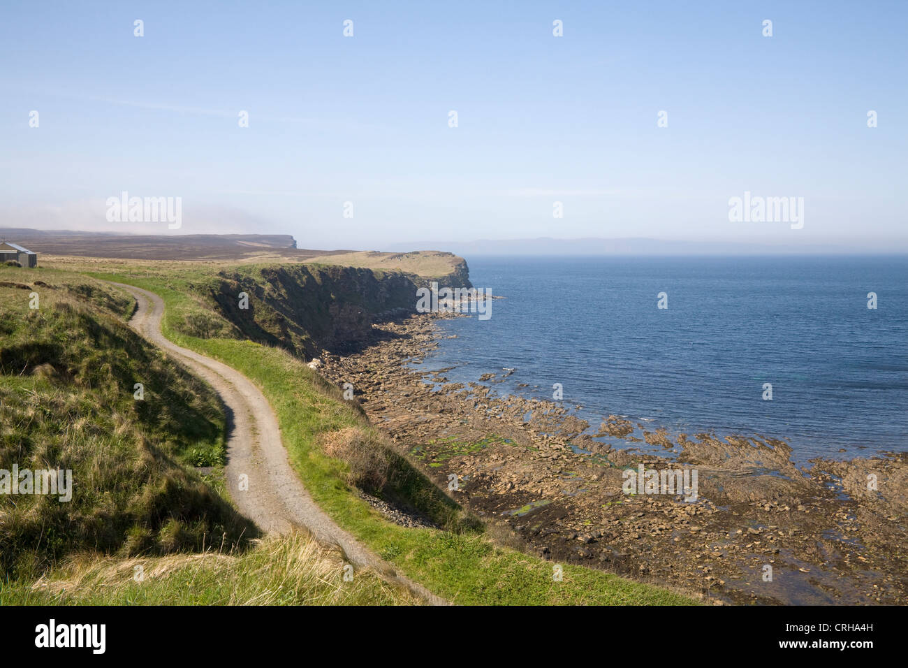 Caithness North Scotland May the rocky cove of Dunnet Head opening into Pentland Firth at low tide view along the - Stock Image