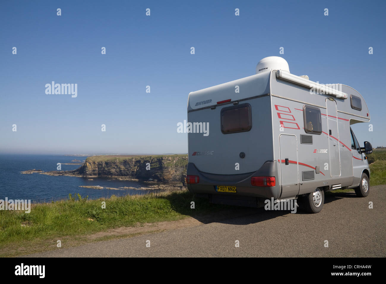 Caithness North Scotland May Motor home parked above rocky cove of Dunnet Head at low tide - Stock Image