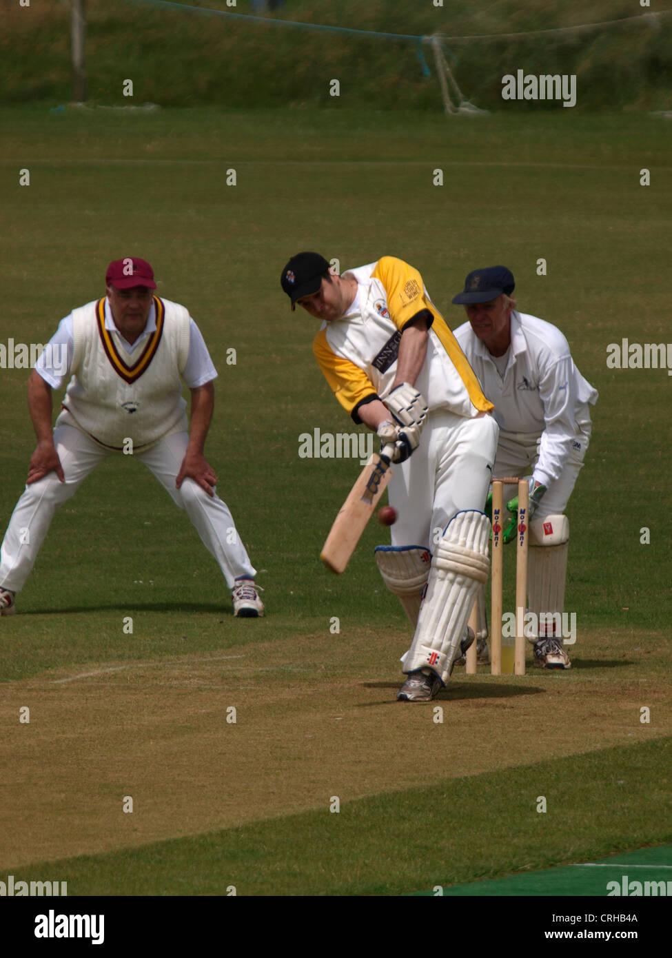 Batsman playing a shot, Bude, Cornwall, UK - Stock Image
